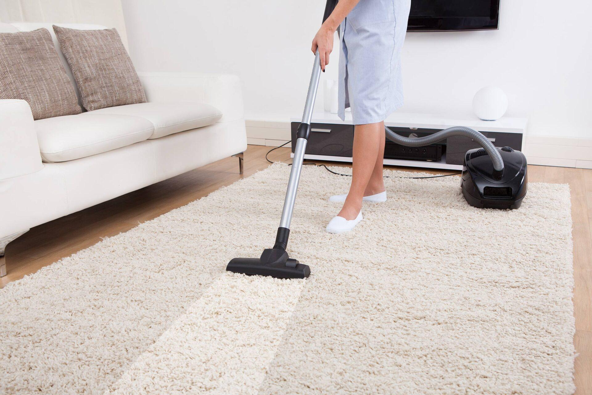woman vaccum cleaning carpet
