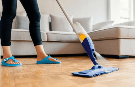 mop spraying cleaner on linoleum floor